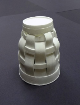 Create a sculpture by deconstructing a styrofoam cup.
