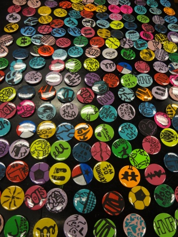 Buttons made from lino-prints, ready to sell for our art classroom fundraiser!