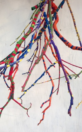 Elementary students used color theory to paint branches as a collaborative project.