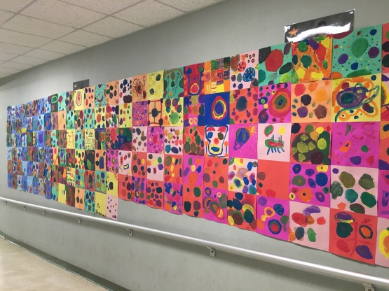 Elementary students paint artwork inspired by Kandinsky.