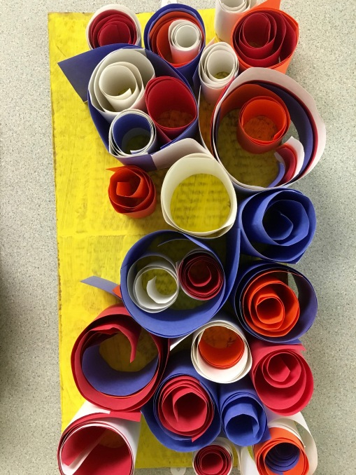 Students create abstract sculptures using paper and art paste.