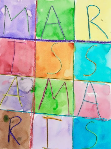 Draw a grid with crayon and fill it with letters. Paint over it with watercolors to create a wax resist.